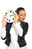 Business woman smiling behing clock Stock Photo