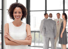Business woman smiling in from of Business team Royalty Free Stock Images