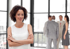 Business woman smiling in from of Business team Stock Photos