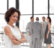 Business woman smiling in from of Business team Royalty Free Stock Photo
