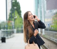 Business woman smiling and calling by mobile phone Stock Photo