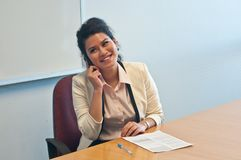 Business woman call to inquire more details and talk. Business woman is smiling while calling to inquire more details and talk over phone Stock Photography