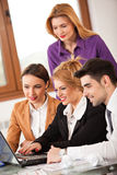 Business woman smiling with colleagues in background Stock Images