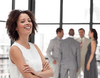 Business woman smiling in front of Business team Royalty Free Stock Photography