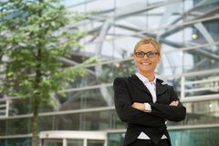 Business woman smiling with glasses in the city Royalty Free Stock Photo