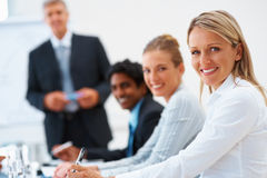 Business woman smiling with her colleagues Stock Photography