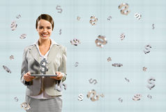 Business woman smiling and holding a table Stock Photography