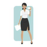 Business woman smiling and holds business card Royalty Free Stock Photography