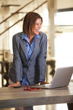 Business woman smiling with laptop computer Royalty Free Stock Photo
