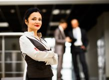 Business woman smiling, in an office environment Royalty Free Stock Photography