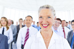 Business Woman Smiling Among the Other Royalty Free Stock Photography