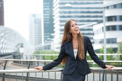 Business woman smiling outdoors Stock Photo