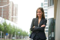 Business woman smiling outdoors Royalty Free Stock Photography