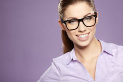 Business woman smiling over blue  background Royalty Free Stock Photos