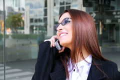 Business woman smiling on the phone Stock Photography
