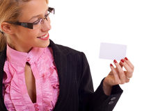 Business woman smiling presenting card Royalty Free Stock Photo
