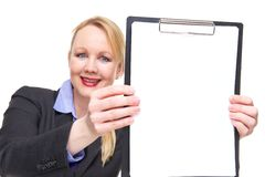 Business woman smiling and showing sign clipboard. Portrait of a business woman smiling and showing sign clipboard Royalty Free Stock Image
