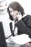 Business woman smiling and talking on the phone Stock Photos