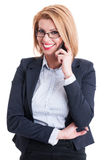 Business woman smiling while talking on the phone Stock Photo