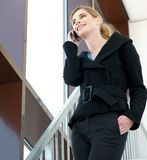 Business woman smiling and talking on the phone Stock Photo