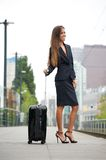 Business woman smiling at train station Stock Photo