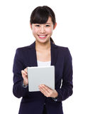 Business woman smiling using tablet pc Royalty Free Stock Image