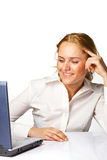 A business woman smiling while working on laptop Royalty Free Stock Photos