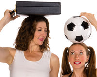 Business woman and soccer player Stock Images