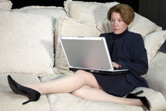 Business Woman on Sofa Stock Photo