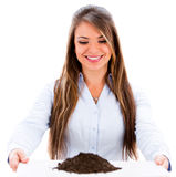 Business woman with soil Royalty Free Stock Images