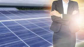 Business woman on solar energy background. Business about Natural energy concept Royalty Free Stock Image
