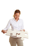 Business woman solving jigsaw stock photos