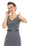Business woman speaking cellphone Stock Photos