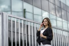 Business woman speaking cellphone Stock Image