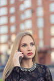 Business woman speaking cellphone on the street Stock Photography