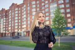Business woman speaking cellphone on the street Royalty Free Stock Photography