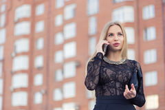 Business woman speaking cellphone on the street Royalty Free Stock Images