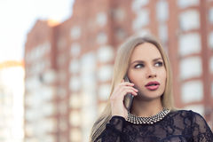 Business woman speaking cellphone on the street Royalty Free Stock Photos