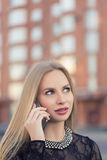 Business woman speaking cellphone on the street Stock Images