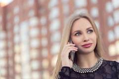 Business woman speaking cellphone on the street Royalty Free Stock Image