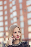 Business woman speaking cellphone on the street Royalty Free Stock Photo