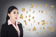 Business woman speaking about number from his mouth Stock Photos