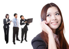 Business woman speaking phone with group Stock Images