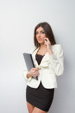 Business woman speaks on mobile with notebook Stock Photo