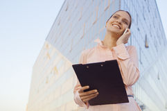 Business woman speaks by the mobile and smiles stock photo