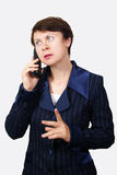 The business woman speaks on the phone. On white background Stock Photo
