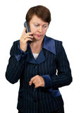 The business woman speaks on the phone. On white background Royalty Free Stock Photography