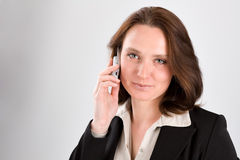 The business woman speaks by phone Royalty Free Stock Photography