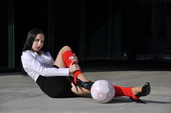 Business woman in sport outfit. With a football ball Royalty Free Stock Photography