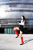 Business woman in sport outfit. With a football ball Stock Photo